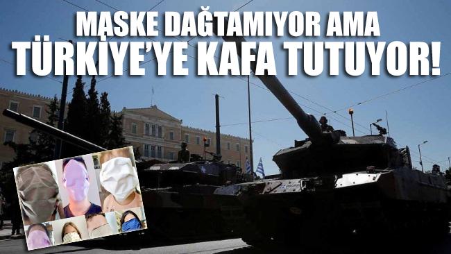Maske dağıtamıyor silahlanma ve Türkiye'ye kafa tutma peşinde!